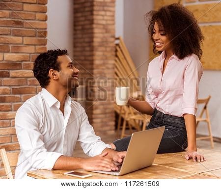 Attractive Afro-american Couple Working