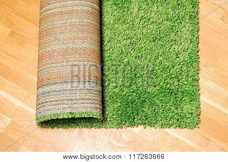 rolled carpet on the floor