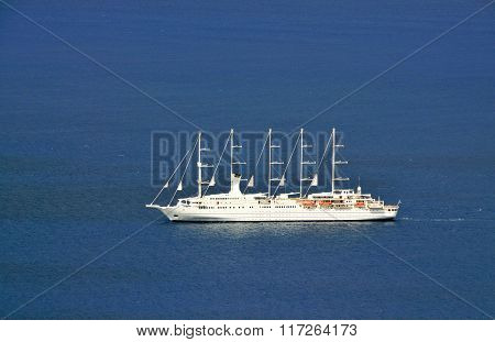 Sailing Cruise Ship In The Blue Waters Of The Caribbean