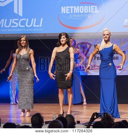 Female Figure Models In Evening Dress Show Their Best