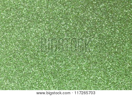 Background Shining Uniformly Colored Green Glitter
