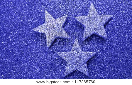 Three Large Stars On Bright Red Background Illuminated