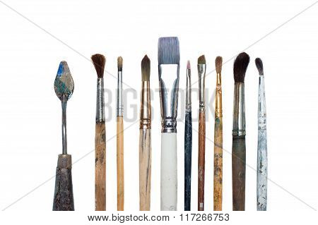 Old oil paint brushes isolated