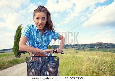 beautiful girl with vintage bike outdoor, summer time