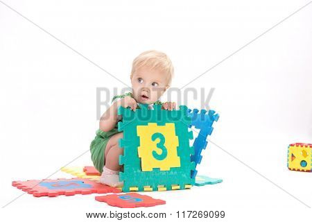 little child baby playing with numbers count learning isolated on white studio shot