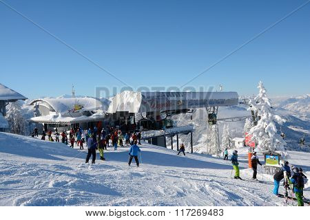 Skiers On Slope And Ski Lift.