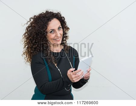 Modern Mature Woman, Happy And Smiling, Use The Tablet.