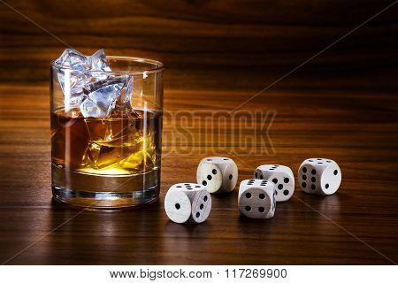 Whiskey With Ice And Dice On A Warm Toned Wooden Table, Concept Of Addiction