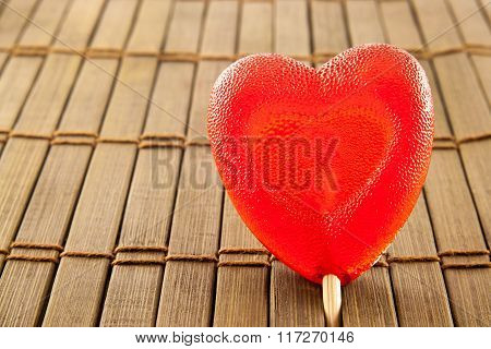 Valentine Day Concept - Heart Shaped Lolly Pop On Wood Background