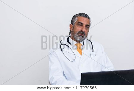 Doctor Uses The Laptop In His Studio.