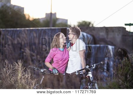 Young Caucasian Sports Couple Dating Outdoors With Mtb Bikes Nearby.