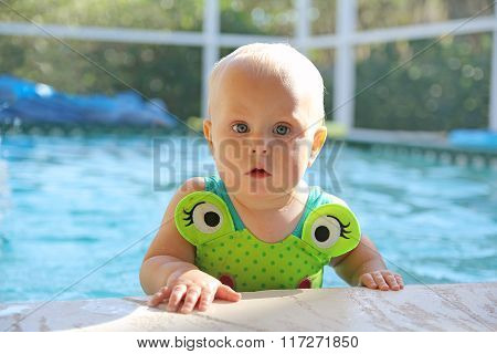 Cute Baby Girl In Swimming Pool On Summer Day