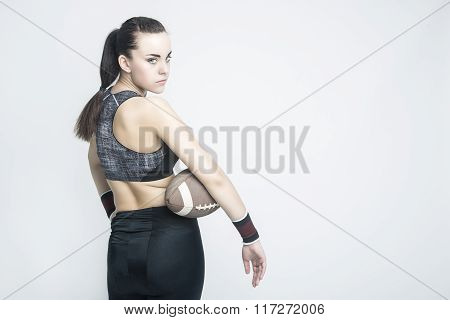 Fitness, Sport Concepts And Ideas. Sportive Caucasian American Football Female Player Athlete Posing