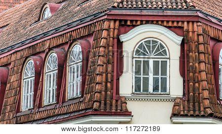 Mansard windows on a tile roof of the house in Tallinn