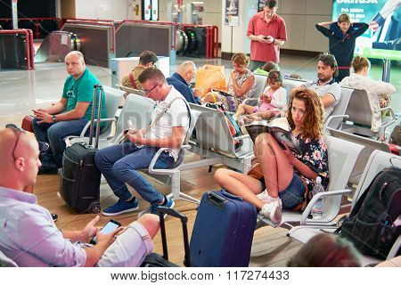 ROME, ITALY - AUGUST 16, 2015: woman read book in Fiumicino Airport. Fiumicino - Leonardo da Vinci International Airport is a major international airport in Rome, Italy