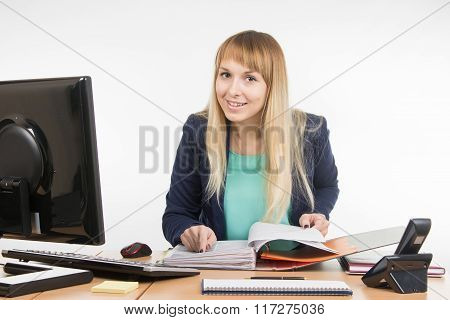 Business Woman Looks Through Documents In The Folder And Looked Into The Frame
