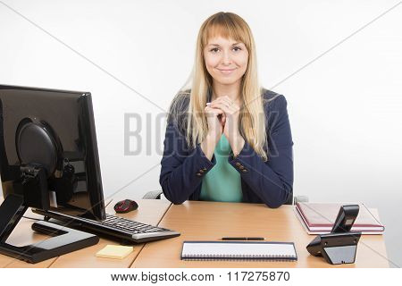 Beautiful Business Woman At The Desk