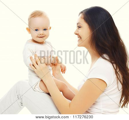 Happy Smiling Mother And Baby Having Fun Together On A White Background