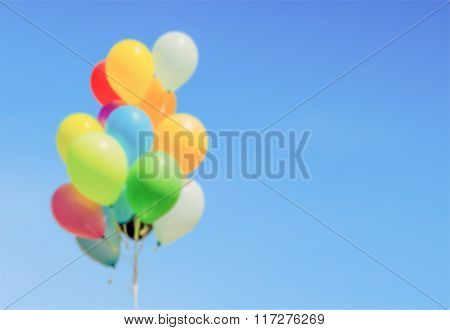 Defocused Background Of Colorful Helium Balloons Isolated On Background