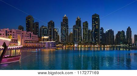 Lake Near Burj Khalifa In Dubai At Night With Skyscrapers In The Background