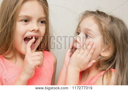 Six-year Girl Showing Her Sister Loose Baby Tooth