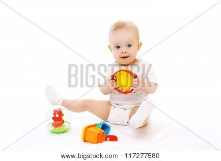 Cute Little Baby Playing With Toys On White Background