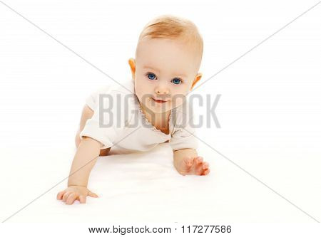 Cute Smiling Baby Crawls On A White Background