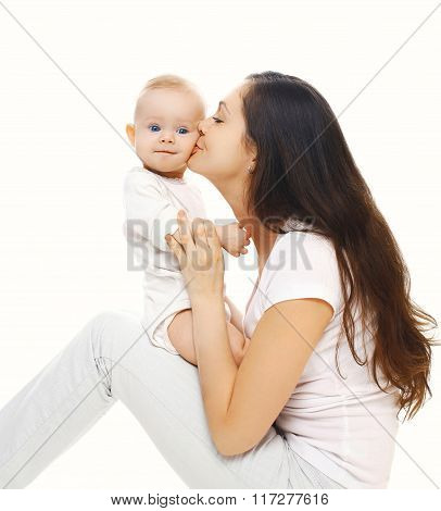 Happy Mother Kissing Her Baby On A White Background