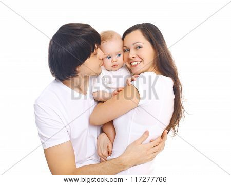 Happy Young Family, Mother And Father Kissing Baby On A White Background