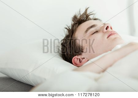 Young Boy Enjoying A Relaxing Sleep