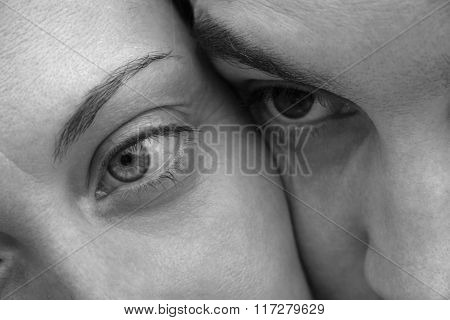Face Men And Women Close Up. Black And White Photo Of A Very Expressive Eyes Loving Couple.