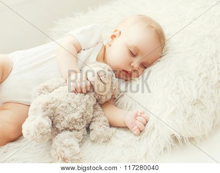 Cute Baby Sleeping On Soft Bed At Home