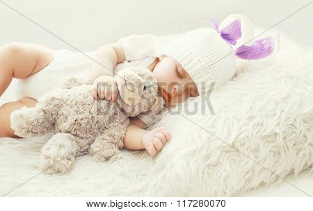 Cute Baby Sleeping With Teddy Bear Toy On White Soft Bed At Home