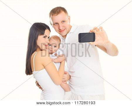 Happy Family, Mother And Father With Baby Makes Self-portrait On Smartphone