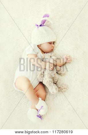 Sweet Baby Sleeping With Teddy Bear Toy On White Soft Bed At Home Top View