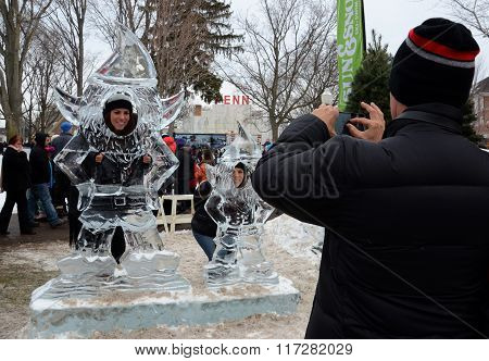 Man Taking Photographs At Plymouth Ice Festival