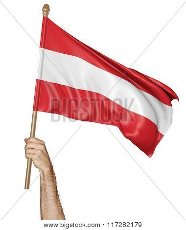 Hand proudly waving the national flag of Austria