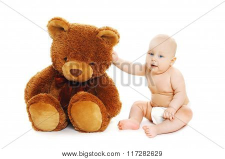 Cute Baby Sitting With Big Teddy Bear On White Background