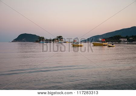 Cameo Island And Agios Sostis Port At Dusk