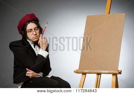 Funny artist in dark studio