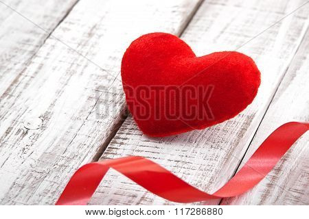 Red Heart With Ribbon On Rustic White Wooden Table. Valentine's Day And Mother's Day Background. Ton