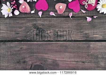 Composition With Candles, Flowers And Hearts On Dark Rustic Wooden Background With Copy Space For Te