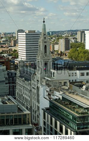 View from a tall building in the City of London looking across Finsbury Square in Islington towards Kings Cross and Hampstead. The tower of Trident House topped with a statue of the Roman God Mercury is to the foreground.