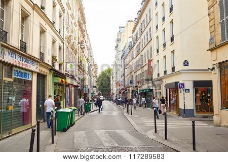 PARIS, FRANCE - AUGUST 10, 2015: Paris streets. Paris, aka City of Love, is a popular travel destination and a major city in Europe