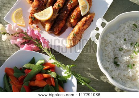 Plate of Chicken Fingers with steamed Jasmine Rice and Vegetables