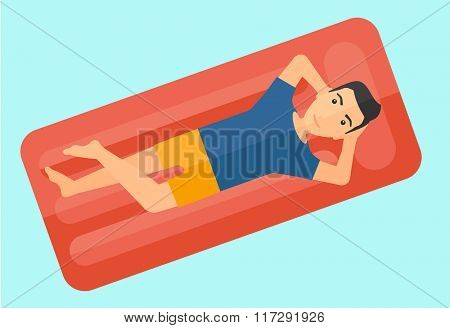 Man relaxing in swimming pool.