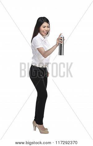 Asian Business Woman Spraying Something