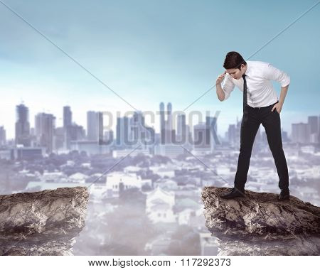 Business Person Looking Down From Top Of The Cliff