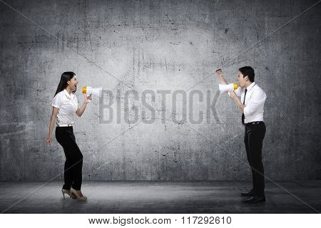 Asian Business Man And Woman Shout Each Other