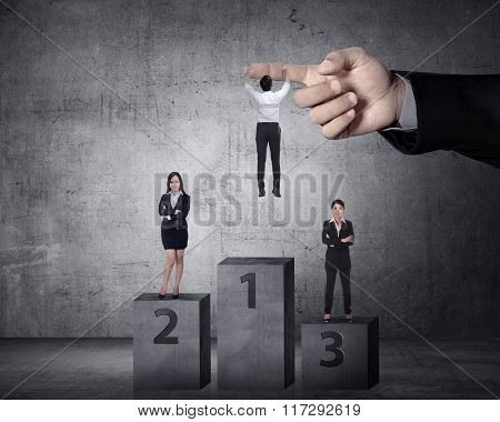 Asian Business Person Hanging On The Large Hand